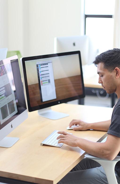 Web developer at desk
